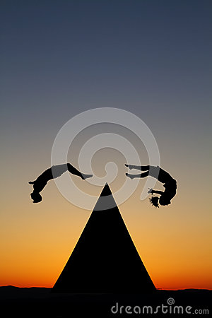 Silhouetted parkour traceurs