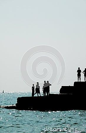 Silhouetted People On Brighton Coast