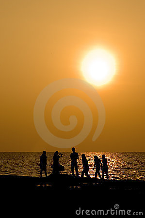 Silhouetted Peoples At Sunset