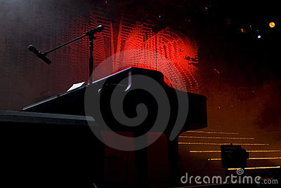 Silhouetted Piano Shape on Stage
