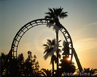 Silhouetted roller coaster at sunset
