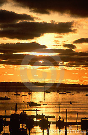 Free Silhouetted Sailboats In Harbor At Sunset Royalty Free Stock Images - 23150209