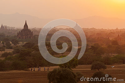 Burmese People at Sunset in Bagan Editorial Photo