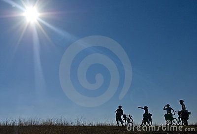 Silhouettes of bicyclists
