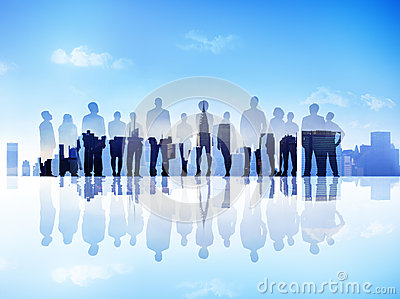 Silhouettes of Business People on a City Scape Looking Up