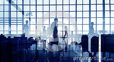 Silhouettes of Business People Walking Inside the Office