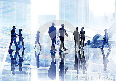 Silhouettes of Business People Wallking Inside the Office
