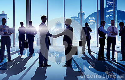 Silhouettes of Businessmen Having a Handshake Stock Photo