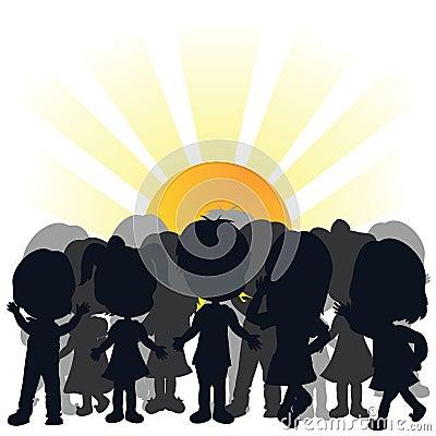 Silhouettes children and rising sun