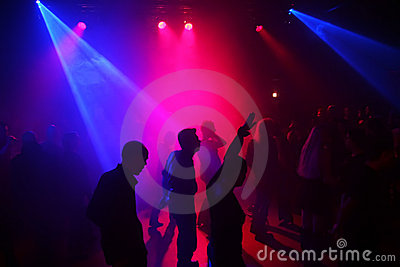 Silhouettes of a dancing teenagers