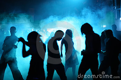 Silhouettes of dancing teenagers