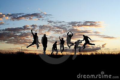 Silhouettes of friends jumping 2