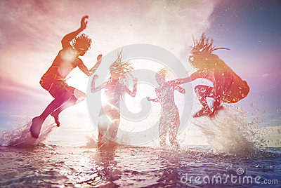 Silhouettes of happy young people