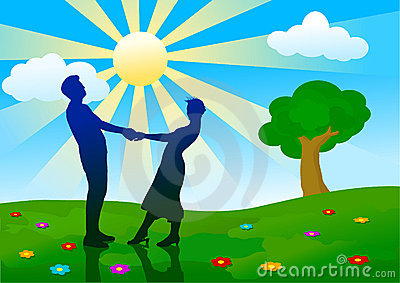 Silhouettes of man and woman standing on meadow