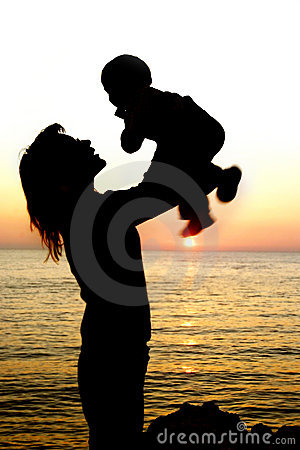 Silhouettes of mother and son