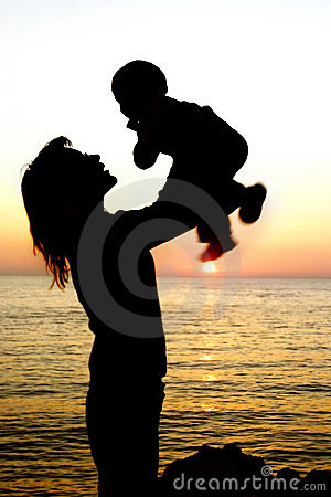 Silhouettes of mother and son partly isolated over
