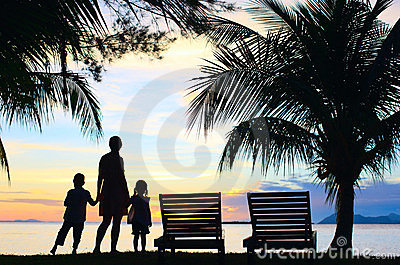 Silhouettes of mother and two kids