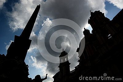 Silhouettes of obelisk, fountain and church. Piazz
