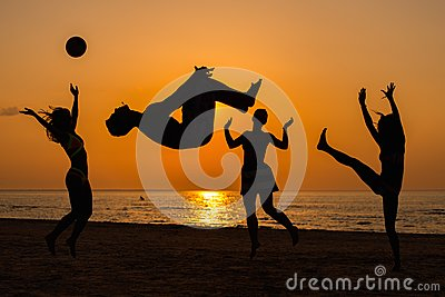 Silhouettes of a people having fun on a beach