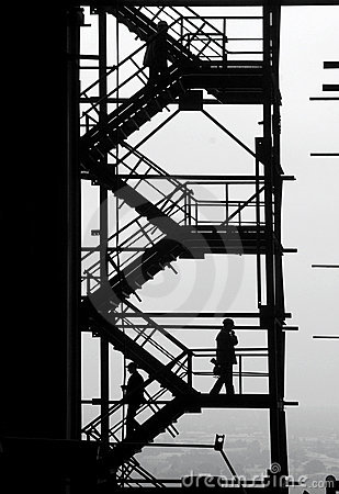 Silhouettes of people at the industrial project