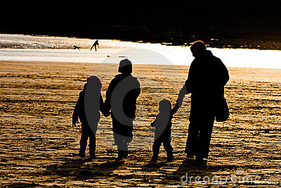 Sillhouetted Family on Beach