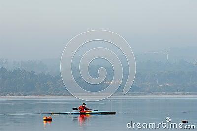 Sillouette of man kayaking