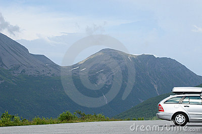 Silver car with carrier in the mountains