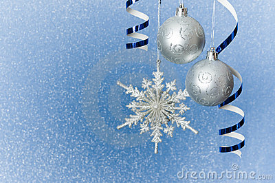 Silver Christmas baubles and snowflake