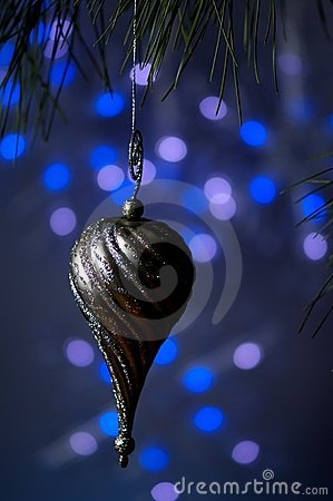 Silver Christmas ornament on a blue background