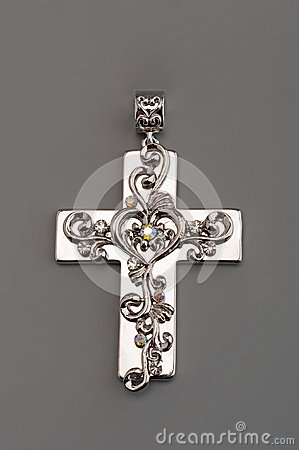 Silver cross on gray