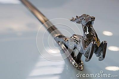 Silver deer car emblem