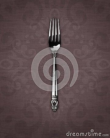 Silver dinner fork on linen