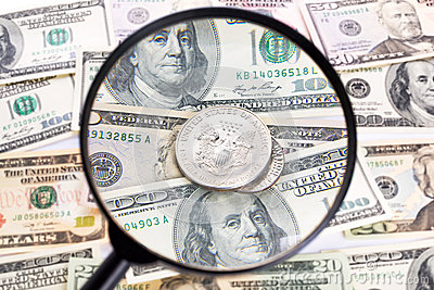 Dollar under magnifying glass