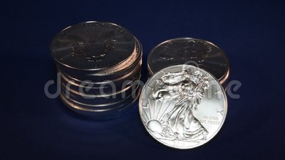Precious Metals Money Silver Eagle American One Ounce Bullion Coins - Finance Illustration. Stacks of one-ounce Silver Eagle bullion coins with one coin leaning stock footage