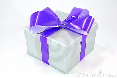 Silver gift box with blue bow isolated on white