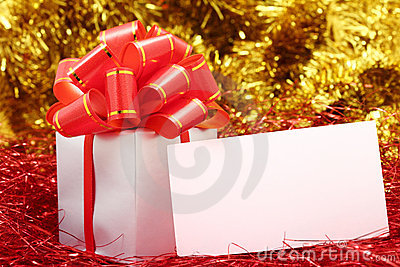 Silver gift wrapped present with red bow