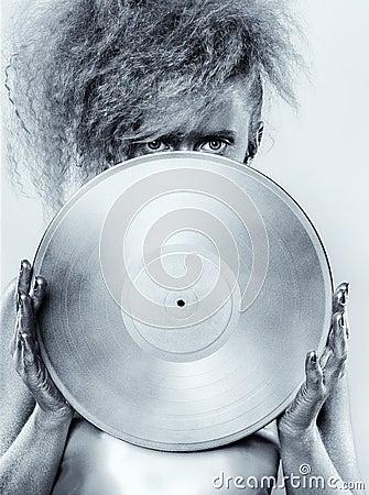Silver girl with vinyl Stock Photo