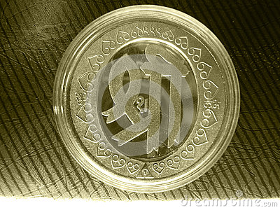 Silver gold metal vintage coin with sacred symbol