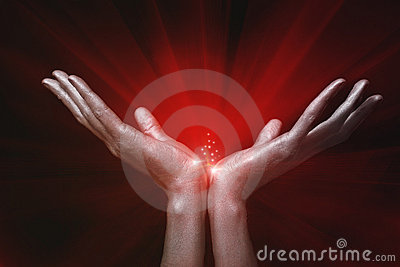 Silver men s hands holding red magic glow