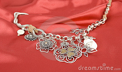 Silver necklace  on the red silk