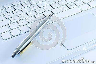 Silver pen on a laptop keyboard