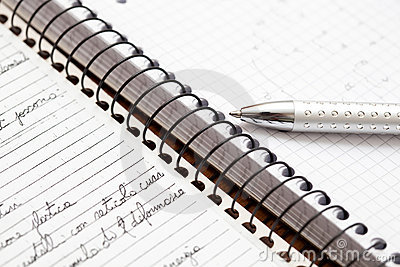 A silver pen on a notebook