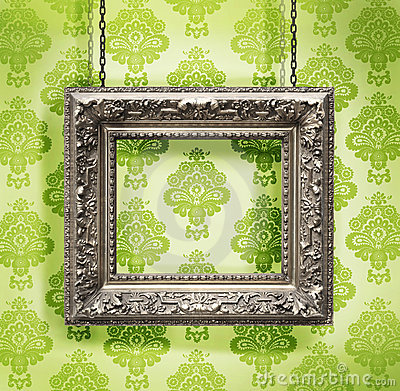 Free Silver Picture Frame Hung Against Floral Wallpaper Stock Photo - 6803960