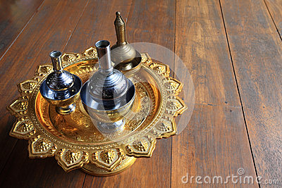 Silver pour water containers on golden tray