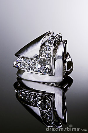 Silver ring with diamonds.