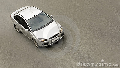 Silver sedan car, driving fast