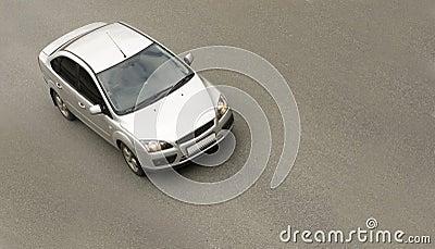 Silver sedan car, driving fast