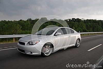 Silver Sports Car speeding on highway