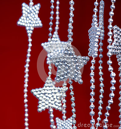 Silver Stars garland on red background