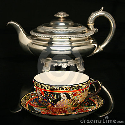 Free Silver Teapot And An Antique Chinese Cup Of Tea Royalty Free Stock Photos - 10525498